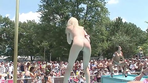 Dancing public chick on stage during outdoor fest