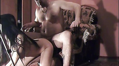 Couple enjoying deep sex in the arm chair