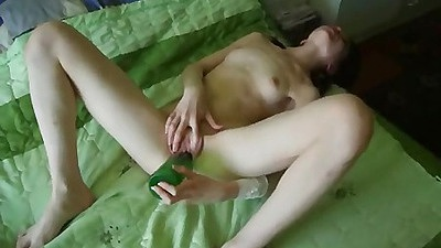 Teen gf shuving a beer bottle into her shaved pussy
