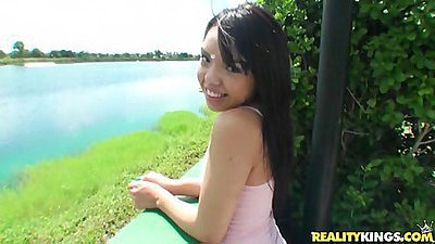 Zenya cute teen near a lak