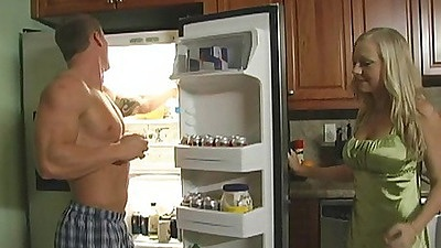 Busty milf sucks cock near her family fridge