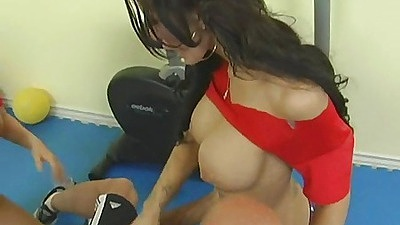 Two babes and a big dick on the gym mat