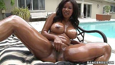 Amaizing big black round tits all oiled up outdoors