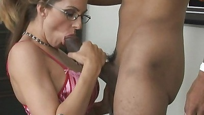 Milf in glasses sucks of a black did behind the desk