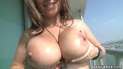 Big natural tits amateur Jasmin posing on the balcony