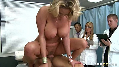 Zoey Holiday sits on cock with doctors watching and anal
