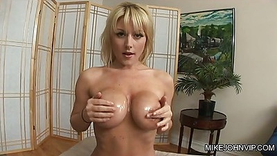 Big tits Velicity Von puts oil all over her round tits and ass then sucks