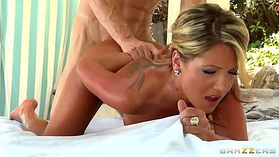 Doggy style sex with oiled up Holly Tyler on massage table with face in pillow