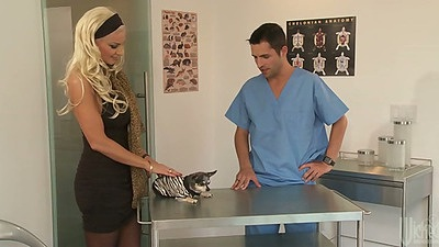 Blonde Brittany Andrews goes to the vet and needs to suck his dick