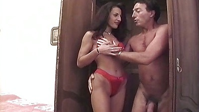 Brunette Nora Davis in red bra and panties receives pussy and ass licking