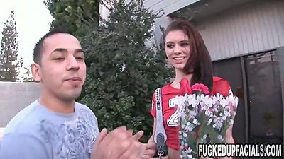 Isabella Amour holding some flowers outdoors and lifting her shirt