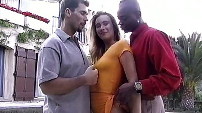 Outdoor threesome with Eva undressing for cocks