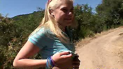 Outdoor teen play with Little Summer in a miniskirt