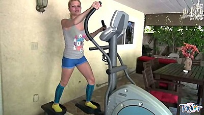 Athletic fully clothed young teen Little taylor working out at the gym