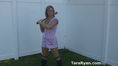 Athletic girl with a bat practicing her swing