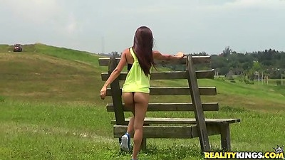 Latina posing outdoors by a skid with Crystal Lopez