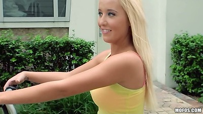 Blonde athletic chick riding her bike outdoors Tucker Starr